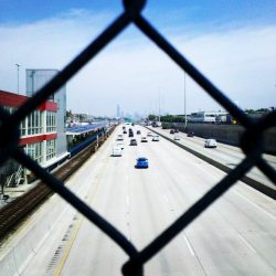 highway viewed through fence